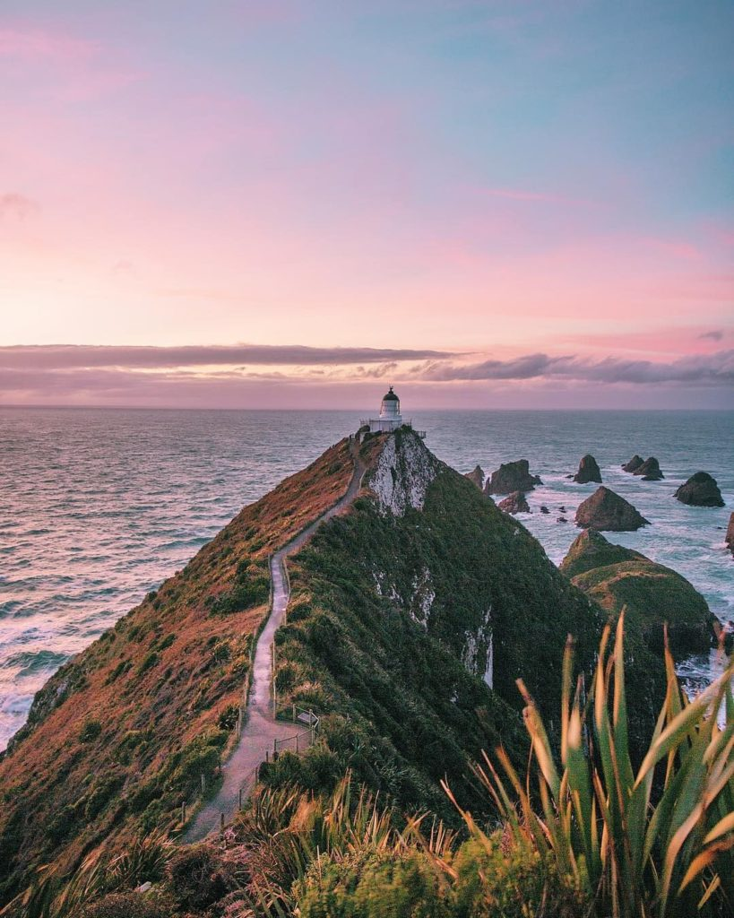 Nugget Point lighthouse by Brooke Saward